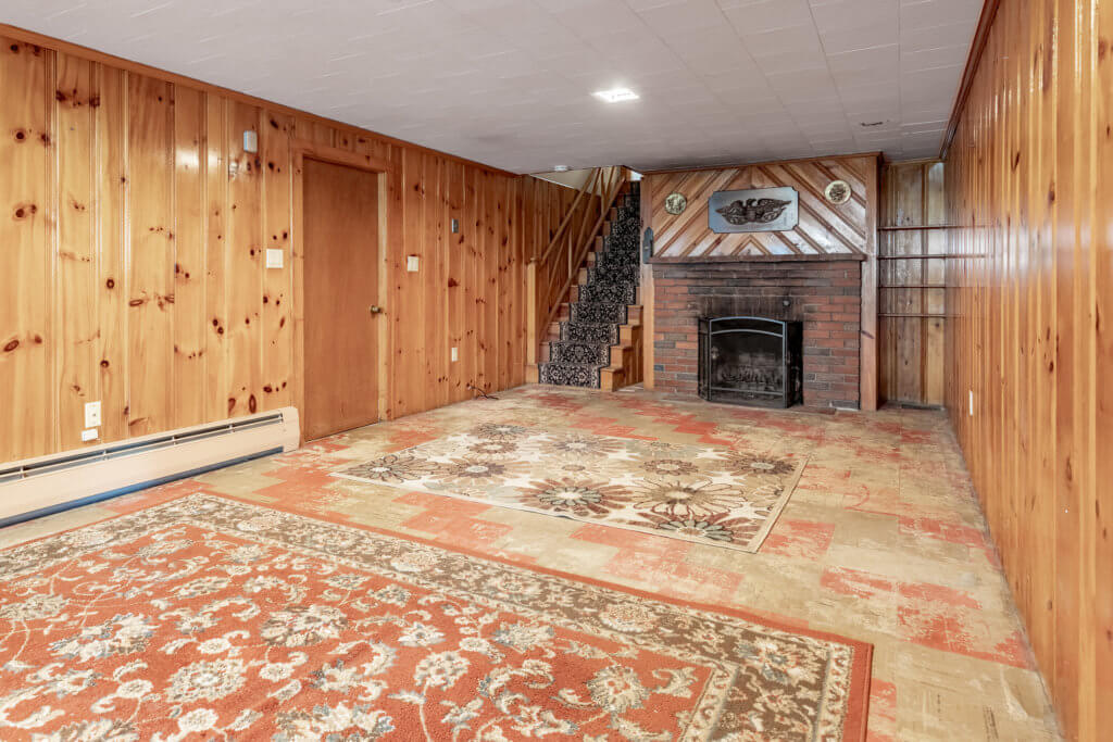 Great Room Facing Utility Storage and Fireplace