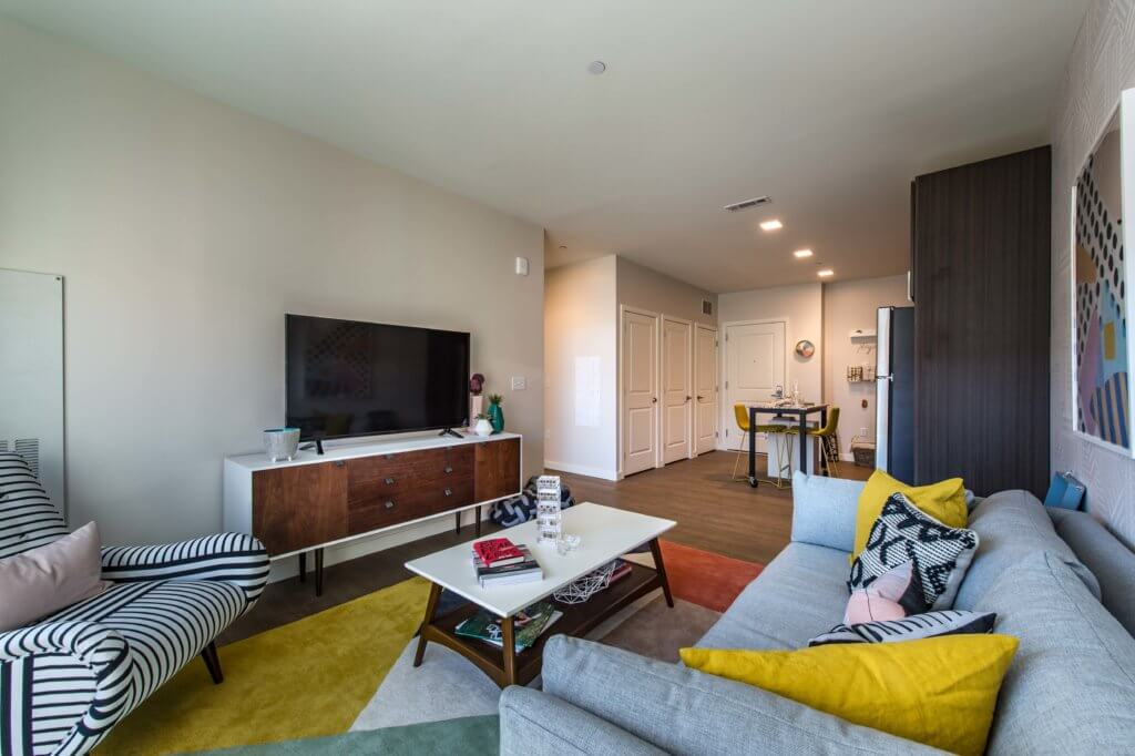 Open Concept, Yellow Pillows, TV, Closets, Recessed Lighting, Wallpaper, Contemporary Artwork, Side Table, J Malden Center, Welcome Home, Malden MA