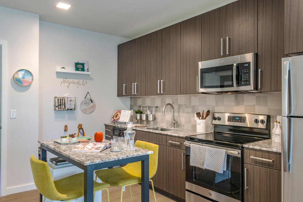 Kitchen, Yellow Chairs, Luxury Kitchen, Modern Cabinets, Plank Flooring, Latte Quartz, Olivewood, Espresso, Stainless Steel, J Malden Center, Rental, Malden MA