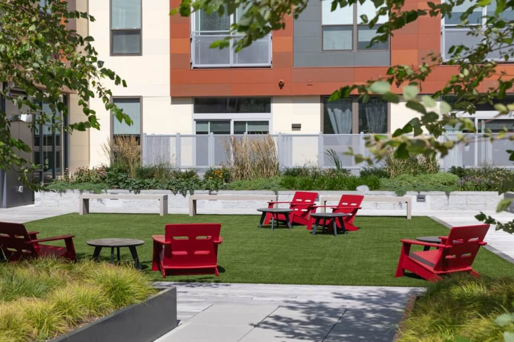 Fitness Lawn, Adirondack Chair, Green Grass, Plantings, Outdoor Space, J Malden Center, Red Chairs